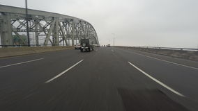 4K UltraHD A POV drive on a busy expressway over a large bridge stock video