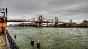 4K UltraHD The Queensboro Bridge with boats on the East River stock video