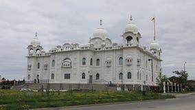 4K UltraHD Timelapse av den sikh- templet Gurdwara Dashmesh Darbar i Brampton, Kanada arkivfilmer