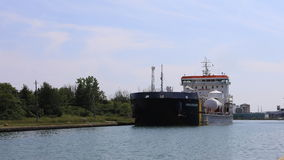4K UltraHD Timelapse of Lake freighter moves down the Welland Canal, Canada stock video