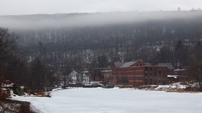 4K UltraHD A timelapse of mist moving over a frozen River and an old mill. 4K UltraHD Timelapse of mist moving over a frozen River and an old mill stock footage