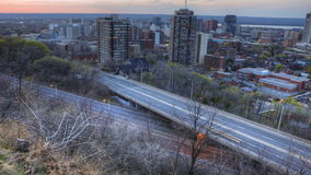 4K UltraHD Timelapse view of a busy expressway at as day becomes night stock video