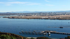 4K UltraHD A timelapse view of the San Diego skyline, ships moving in front stock video