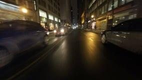 4K UltraHD uma movimentação do ponto de vista da noite (POV) na grande cidade video estoque