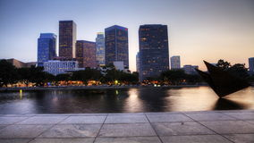 4K UltraHD View at dusk of Los Angeles skyscrapers with reflecting pool in the foreground