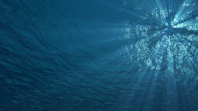 4K underwater ocean waves seamless loop animation with light rays