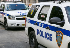 K-9 unit cars in NY. New York City, USA - May 19, 2014: Two K-9 unit cars of the Port Authority Police near 9/11 memorial Royalty Free Stock Images