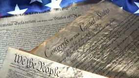4k United States Bill of Rights Preamble to the Constitution and American Flag. Historical Document US Constitution - We The People with American Flag stock footage