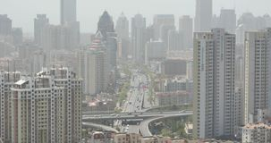 4k urban city busy traffic jams,QingDao,china.business building,air pollution.