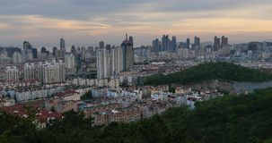 4k urban city in dusk,busy traffic jams & business building,QingDao,china. Gh2_11435_4k stock video