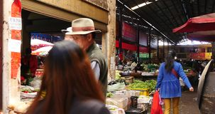 4k variety of food & Life items in large outdoor trade market,Shangri-La,china. 4k variety of food & Life items in large outdoor trade market Shangri-La stock footage