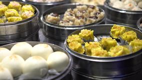 4K Vendor selling Dumpling and Shaomai in Asian Street Food Market of Taiwan. 4K Vendor preparing and selling Shaomai and customers at Asian Street Food Market stock footage