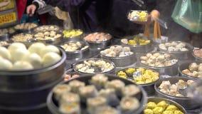 4K Vendor selling Dumpling and Shaomai in Asian Street Food Market of Taiwan. 4K Vendor preparing and selling Shaomai and customers at Asian Street Food Market stock video