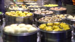 4K Vendor selling Dumpling and Shaomai in Asian Street Food Market of Taiwan. 4K Vendor preparing and selling Shaomai and customers at Asian Street Food Market stock video footage