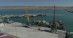 4K video aerial survey Cranes for loading and unloading containers on commercial vessels stock video