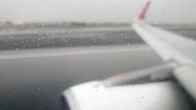 4k video of airplane taking off the wet runway during heavy rain storm