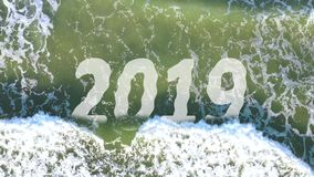 4k Video Concept of wave washing away the year 2019 and bringing 2020 stock video