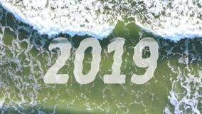 4k Video Concept of wave washing away the year 2019 and bringing 2020 stock video footage
