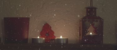 4,5k video light of christmas candles lit on the fireplace stock footage