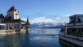 4K video of Oberhofen castle and Berner Oberland mountains. stock video