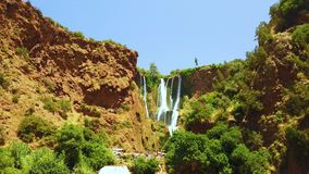 4K video of Ouzoud waterfalls, Grand Atlas in Morocco. This beautiful nature background is situated in Africa. It is a. Close-up video of tall waterfalls in the stock video footage