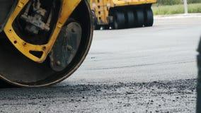 Compact steamroller flatten out the asphalt. stock video footage