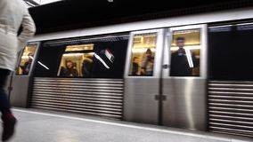 4K video of Romanian subway or tube arriving at the station and people getting out