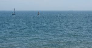4k video,sailboat sailing in the sea,wide ocean waves surface. stock video footage