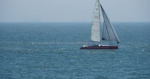 4k video,sailboat sailing in the sea,wide ocean waves surface. stock footage