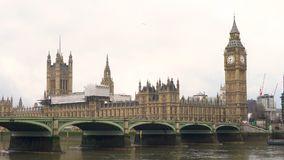 Westminster Bridge over the River Thames next to Big Ben and The Houses of Parliament stock footage