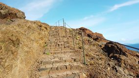 4K video walk on stone stairs on Madeira island, Portugal. From the cliffs is a beautiful view of the ocean waves. It is