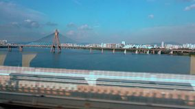 4K Views the bridge Seoul city and famous Han River from the train window