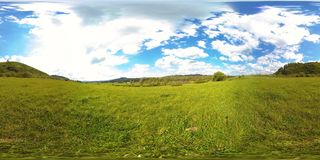 360 VR of a beautiful mountain meadow timelapse at the summer or autumn time. Clouds, green grass and sun rays. 4K 360 VR virtual Reality of a beautiful stock video