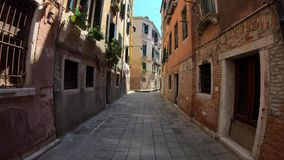 4K. Walking through a typical street in city of Venice, Italy. Subjective shot. stock footage
