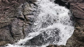 4K Waterfall close up. 4K Waterfall Through Big Rocks close up stock video footage