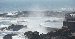 4k waves washed dam,People on shore.ocean sea water & coastal rock surge coast. stock footage