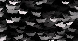 4K White paper boats on black color stock footage