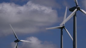 4K wind turbines with clouds moving behind UK stock footage