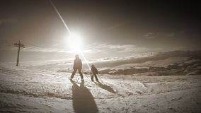4K Winter holiday footage: son skiing with his mother during sunny day stock footage