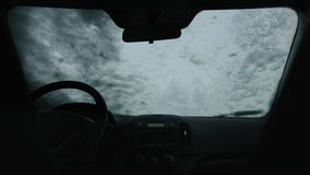 4K Woman Romoving Snow of Windshield stock video footage