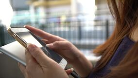 4K Woman Using Smartphone In Street Hongkong To Do Some Quick Text Messaging