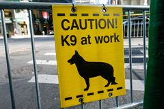 K9 at work. Sign attached to a police barricade royalty free stock photo