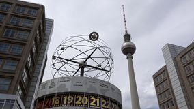 4K. The World Clock and the Television Tower at Alexanderplatz in Berlin stock footage