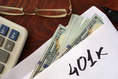 401k written on an envelope with dollars. Savings concept stock images
