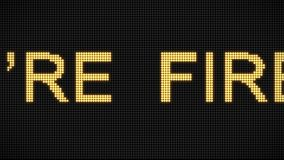 4K Word You are fired on the LED board. Vintage style. Motion graphic and animation background. 4K Yellow glow Word You are fired on the LED board. Vintage stock video footage