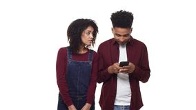 4k young African American couple playing with their phones while on a date. 4k young African American couple playing with their phones while on a date stock video footage