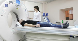 4K Young caucasian male gets scanned by magnetic resonance imaging scanner in modern hospital. stock video footage