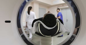 4K Young caucasian man gets scanned by magnetic resonance imaging scanner in modern hospital. stock video footage