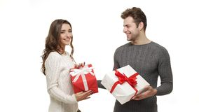 4k Young couple showing and exchanging presents in Chrismas day on white background. 4k Young couple showing and exchanging presents in Chrismas day on white stock video