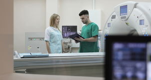4K Young doctor and nurse discussing diagnosis. stock video